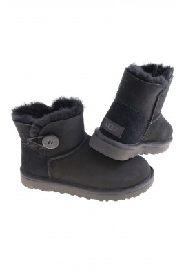Black low boots fastened with a button on the side, UGG