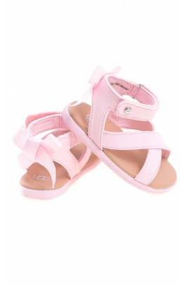 Pink baby sandals fastened around the ankle, UGG